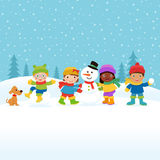 Children building a Snowman Royalty Free Stock Image
