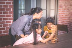 Children building toy block tower with teacher. Children is building toy block tower with teacher stock photography