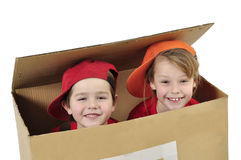 Children building toy house. Funny children sitting in toy house royalty free stock images