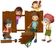 Children building wooden fence Stock Photography