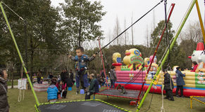 Children bungee jumping in the park,chengdu,china Stock Image