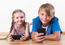 Children burying in mobile phones Stock Photography