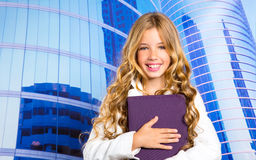 Children business student girl with tablet pc on urban buidings Royalty Free Stock Images