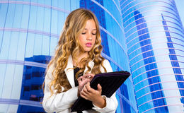 Children business student girl with tablet pc on urban buidings. Children business student girl with tablet pc on urban blue buidings background Stock Photography