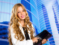 Children business student girl with tablet pc on urban buidings. Children business student girl with tablet pc on urban blue buidings background Stock Image