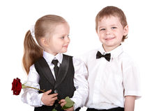 Children in business suit with rose. Stock Photo