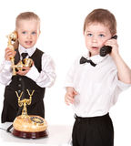 Children in business suit with telephone. Stock Image