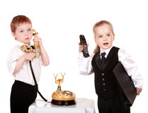 Children in business suit with telephone. Royalty Free Stock Photos