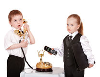 Children in business suit with telephone. Stock Photo
