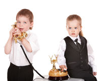 Children in business suit with telephone. Royalty Free Stock Photo