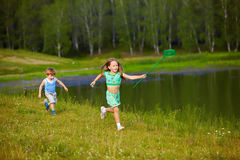 Children with butterfly net Stock Photography
