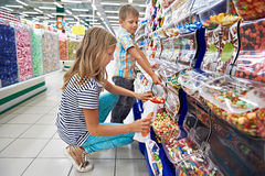 Children buy gummi candy royalty free stock photography