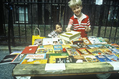 Children buying books at bookfair Royalty Free Stock Images