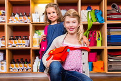 Children buying supplies in handicraft store Royalty Free Stock Image