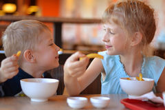 Children in cafe. Eat potato Royalty Free Stock Images