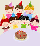 Children with a cake Royalty Free Stock Image