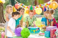 Children and the cake stock photo