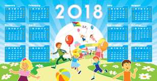 Children with Calendar 2018. Children with smiling faces are playing in kindergarten, New Calendar 2018 in the background Stock Images
