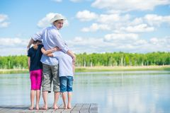 Children came to the river with their father in a hat, beautiful nature stock photos