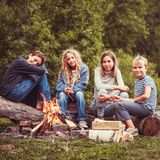 Children in the camp by the fire royalty free stock photos