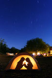 Children Camping at Night in a Tent Stock Images