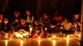 Children in candlelight Stock Photography