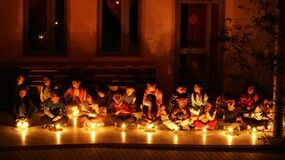 Children in candlelight ceremony Stock Photography