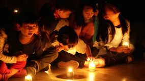 Children at candlelight event Stock Image