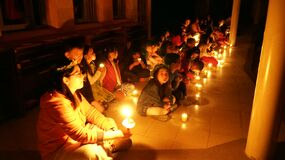 Children with candles on floor Royalty Free Stock Image