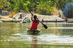 Children canoe in the river Gambia stock images