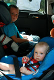 Children in car seat. Sibling - two brothers in car safety seat Royalty Free Stock Photography