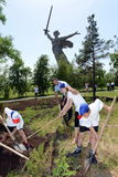 Children caring for green spaces on Mamaev hill. Royalty Free Stock Images