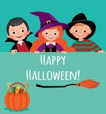Children in carnival costumes of Halloween holding an empty banner Royalty Free Stock Images