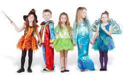 Children in carnival costumes stand