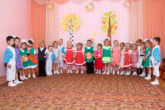 Children in carnival costumes stand in a row Royalty Free Stock Photos