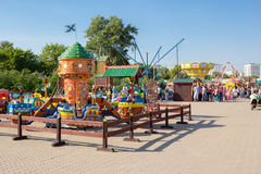 Children carousel in city amusement park Stock Photos