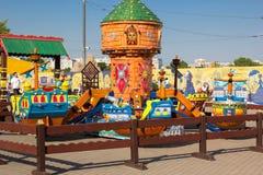 Children carousel in city amusement park Stock Image