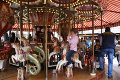 Children on a carousel Stock Photography