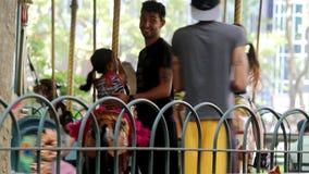Children carousel in New York City's Bryant Park. NEW YORK - SEPTEMBER 03: Children carousel in New York City's Bryant Park on September 03, 2013 in New York stock video