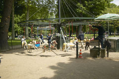 Children on carousel in park, Paris, France Stock Photo