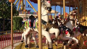 Children on carousel stock video footage