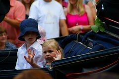 Children in carriage waving. Children in a horse-drawn carriage taking part at the Rakoczi-Fest pageant in the town Bad Kissingen, Germany Stock Photos