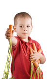 Children and carrots Stock Photos