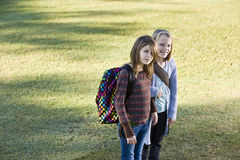 Children carrying backpacks outdoors Royalty Free Stock Photography