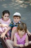 Children in a cart Stock Photo