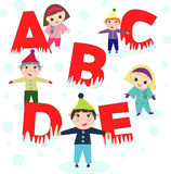 Children cartoon with ABC alphabet in winter Royalty Free Stock Photo