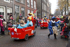 Children in carts escorted by Zwarte Piet Royalty Free Stock Image