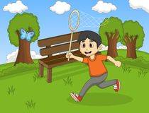 Children catching a butterfly in front of their school cartoon Stock Image