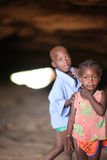 African children playing. Boy and girl playing in a cave Royalty Free Stock Images