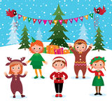 Children celebrate Christmas and New Year Stock Photos